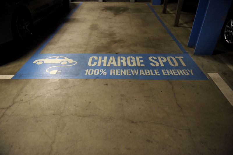 Signage for an electric car charging booth is displayed at Federation Square car park in Melbourne, Australia, on Friday, April 28, 2017.