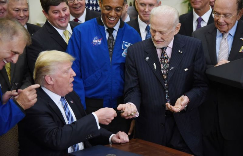 President Donald Trump gives the pen to Buzz Aldrin after signing an Executive Order to reestablish the National Space Council in June.