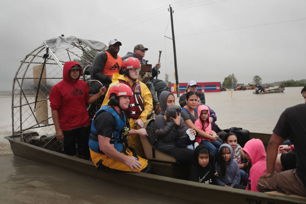 People are rescued from a flooded Houston neighborhood on Monday. The city came together in an amazing way during the tragedy.