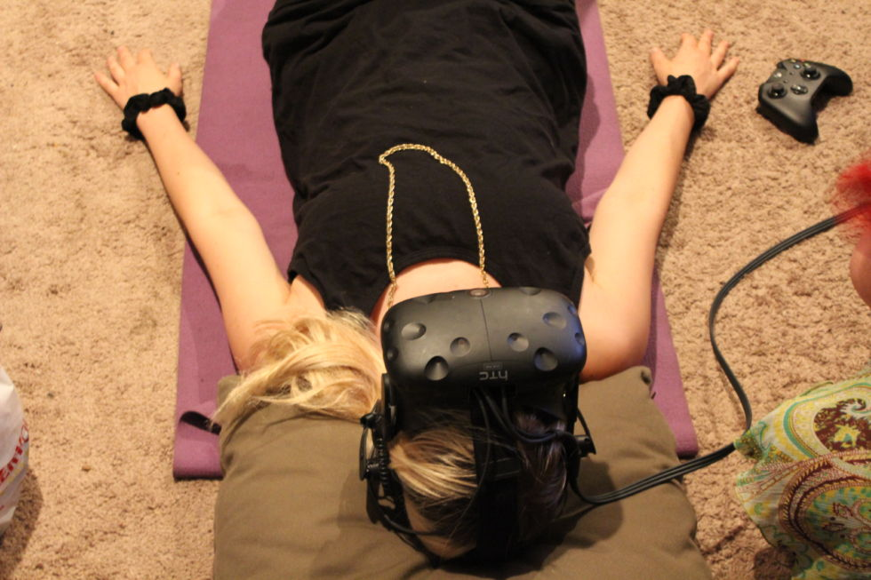 Erika Anderson gets ready for a VR animal massage, presented by VR game and experiment designer Seanna Musgrave.