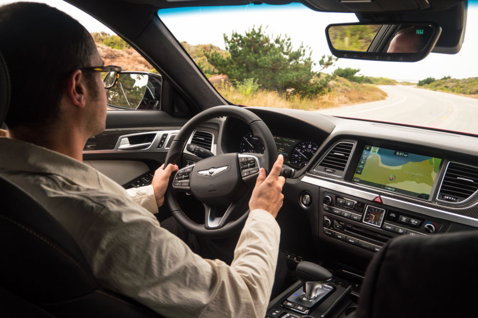 At the wheel of a Genesis G80 on Monterey's 17 Mile Drive.