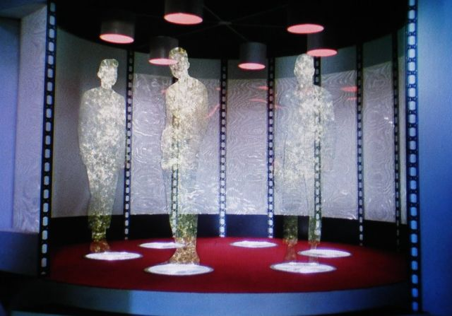 Kirk, Spock, and McCoy beam down.