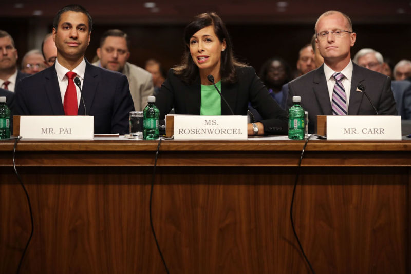 Ajit Pai, Jessica Rosenworcel, and Brendan Carr prepare to testify before the Senate Commerce Committee during a confirmation hearing on July 19, 2017.