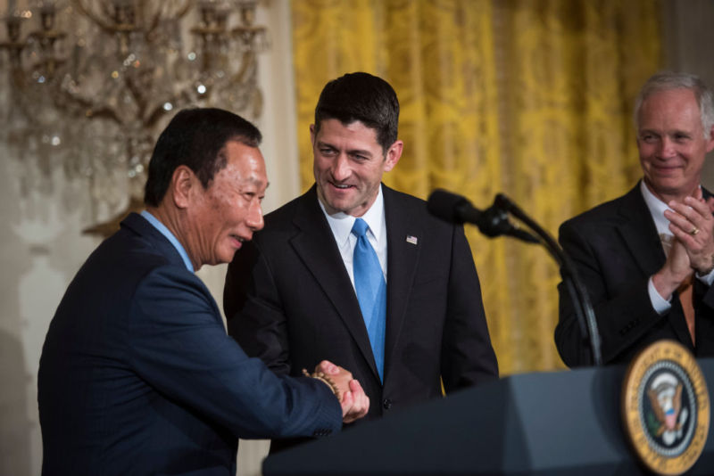 House Speaker Paul Ryan of Wisconsin, greets Terry Gou, president and chief executive officer of Foxconn, before President Donald Trump announces the first US assembly plant for electronics giant Foxconn, in the East Room of the White House on Wednesday, July 26, 2017.