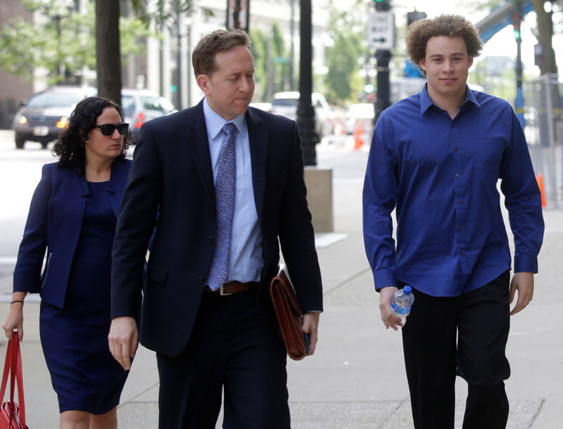 At right, Marcus Hutchins, the British security expert accused of creating and selling malware that steals banking passwords, arrives Monday with his lawyers Marcia Hofmann, left, and Brian Klein, at the federal courthouse in Milwaukee, Wisconsin. He pleaded not guilty to the charges.