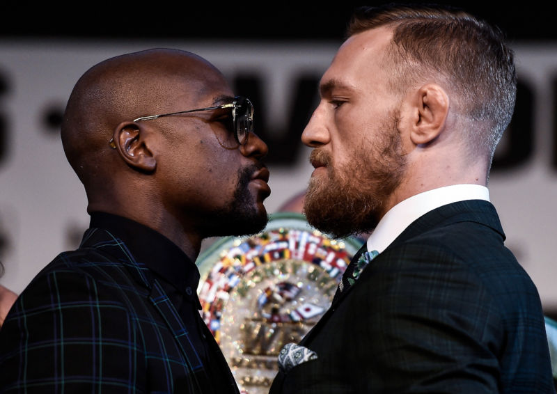 Boxer Floyd Mayweather Jr. , left, and UFC lightweight champion Conor McGregor face off during a news conference at the KA Theatre at MGM Grand Hotel & Casino on Wednesday. The two will meet in a super welterweight boxing match at T-Mobile Arena on Saturday. A judge has ordered piracy sites not to stream the mega-event, but whether they'll abide is anybody's guess.