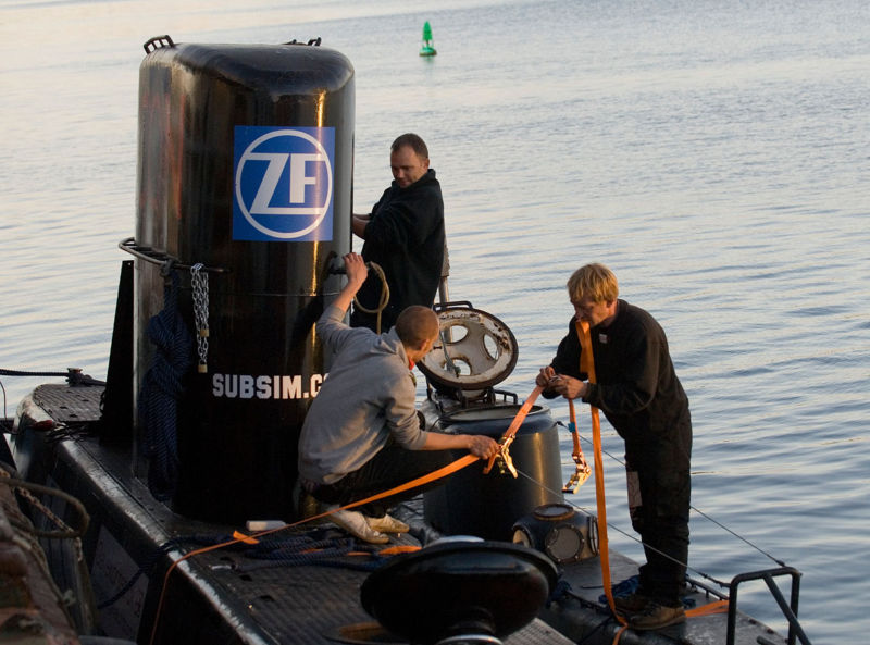 Madsen, right, stands aboard the <em>UC2 Kraka</em>, alongside the <em>UC3 Nautilus</em>, as the two submarines are secured for a test run in this 2008 photo.