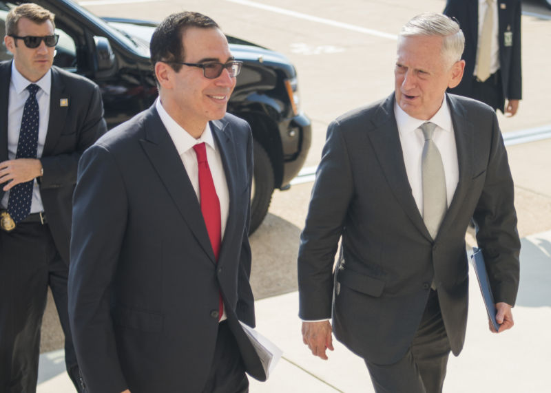 Treasury Secretary Steven Mnuchin, left, chairs the Committee on Foreign Investment in the United States. Defense Secretary James Mattis, right, serves on the committee, which recommended that Trump block the Lattice deal.
