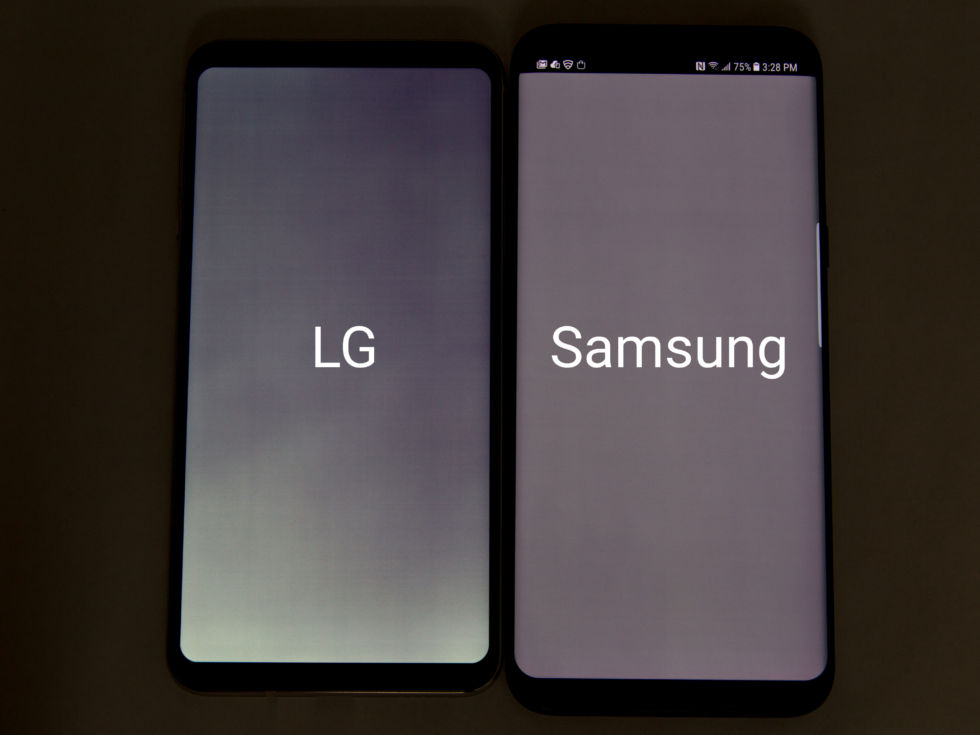 A LG V30 and a Samsung Galaxy S8 displaying a solid gray image on low brightness in a dark room. Click for a bigger version, and note LG's uneven color and weird horizontal banding.
