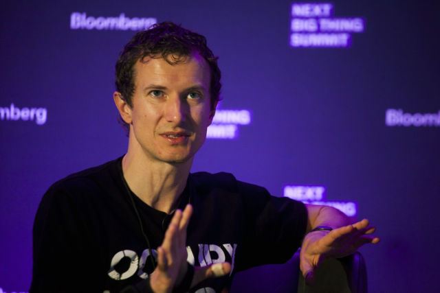Luke Nosek speaks at the Bloomberg Next Big Thing Summit in 2013. His conference t-shirt game spoke to his fondness for a then-new partnership with SpaceX.