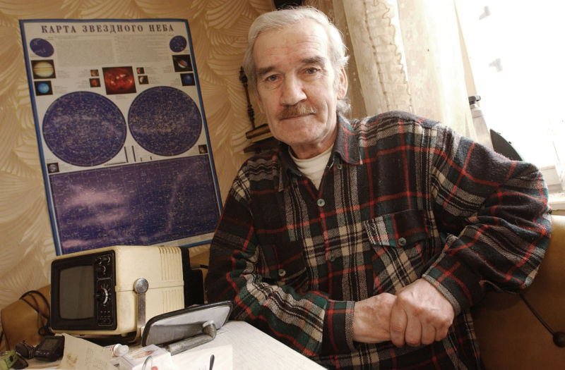 "Former Soviet Colonel Stanislav Petrov sits at home on March 19, 2004 in Moscow. Petrov was in charge of Soviet nuclear early warning systems on the night of September 26, 1983, and decided not to retaliate when a false ""missile attack"" signal appeared to show a US nuclear launch. He is feted by nuclear activists as the man who ""saved the world"" by determining that the Soviet system had been spoofed by a reflection off the Earth."
