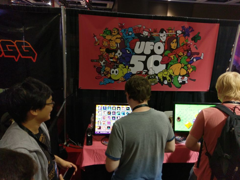 Derek Yu (left) shows off UFO 50 at PAX West.