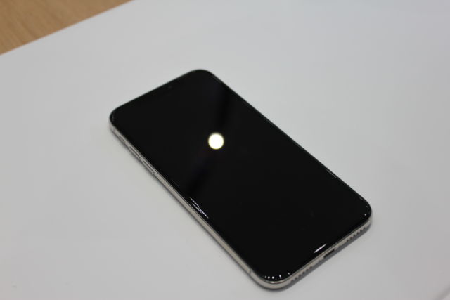 The iPhone X is completely black on the front, and those blacks are the same even when the X is on and there's nothing to show in that pixel.