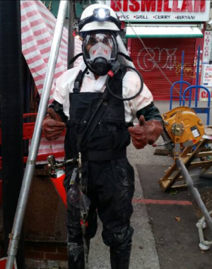A Thames Water employee prepares to attack the latest fatberg.