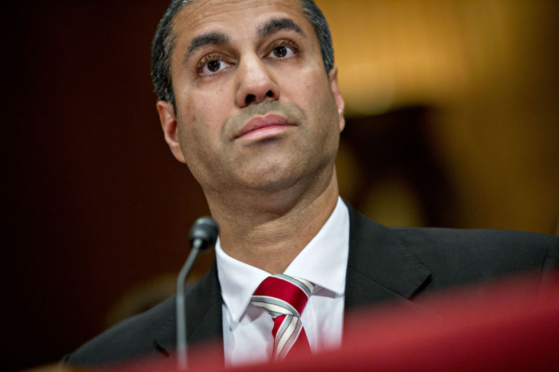 FCC Chairman Ajit Pai listening at a Senate hearing.