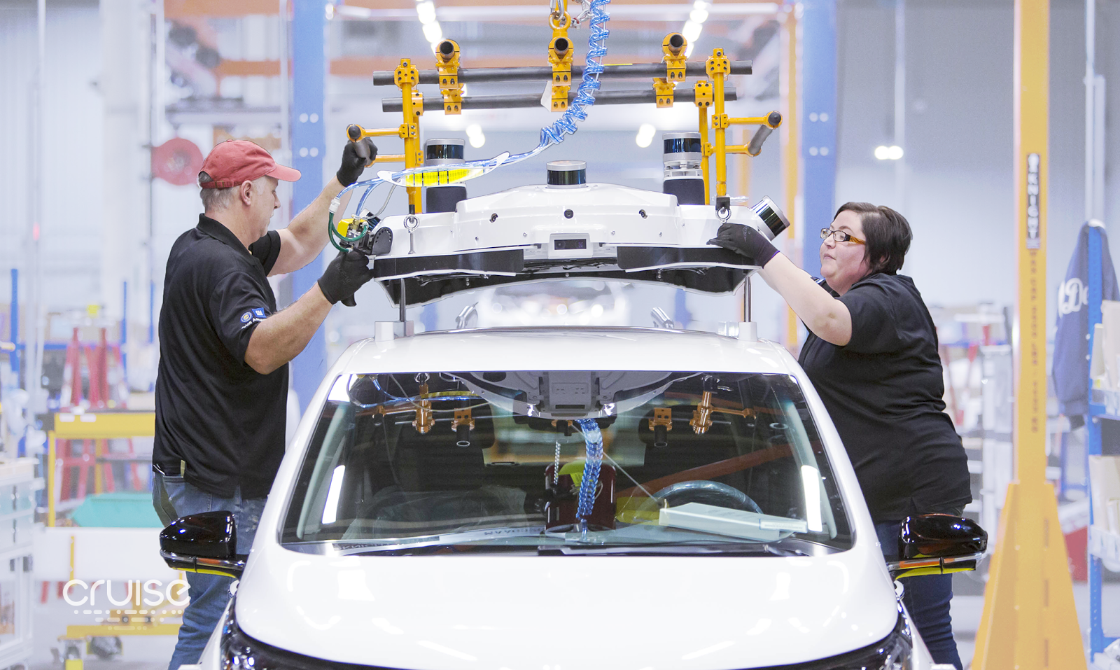 GM workers assembling a test car for Cruise.
