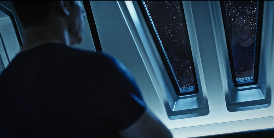 Notice that Lorca's reflection is looking back from the right porthole.