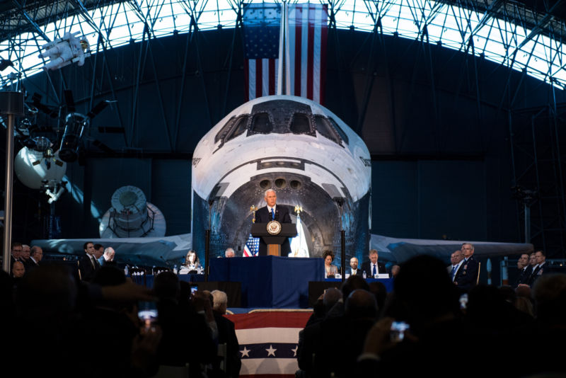 Vice President Mike Pence speaks at Thursday's meeting of the National Space Council in front of a space shuttle.