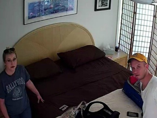 Derek Starnes (right) told police that the hidden camera captured this still (taken from a video) of himself and his wife at their Airbnb rental.