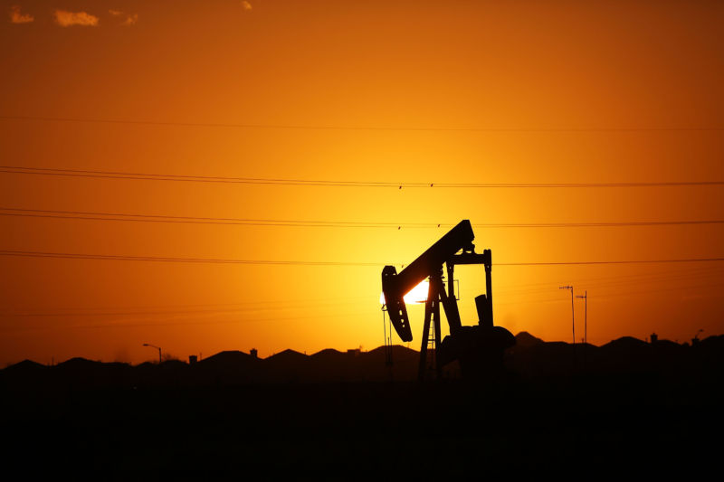 MIDLAND, Tex. - JANUARY 20: A pumpjack sits on the outskirts of town at dawn in the Permian Basin oil field on January 21, 2016 in the oil town of Midland, Texas.