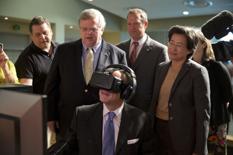 Texas Governor Greg Abbott (center) tests the Oculus virtual reality device at Advanced Micro Devices (AMD) in Austin as AMD CEO Lisa T. Su (r) watches following an Abbott bill signing that reduced Texas' franchise tax by 25 percent in June 2015.