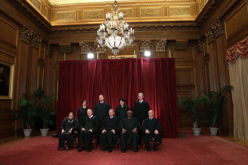 Justices pose for a group portrait in the East Conference Room of the Supreme Court.