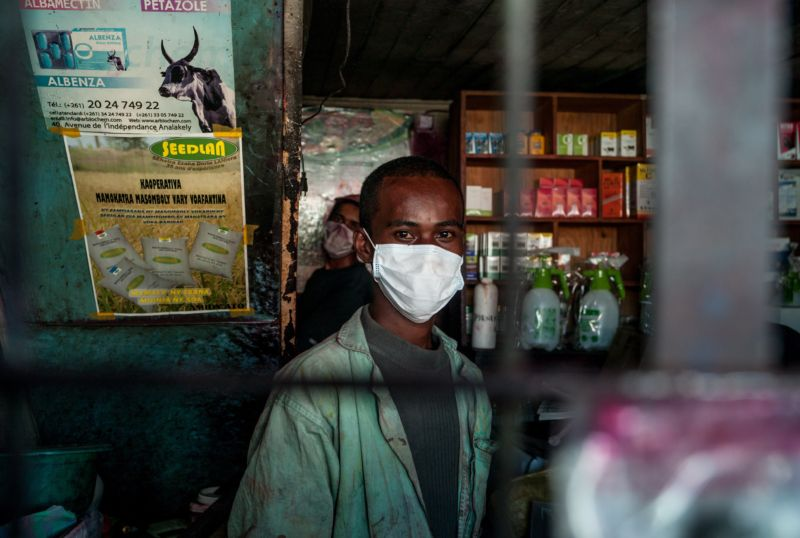 A man wearing a face mask works in Antananarivo, Madagascar, as plague spreads rapidly in cities across the country.