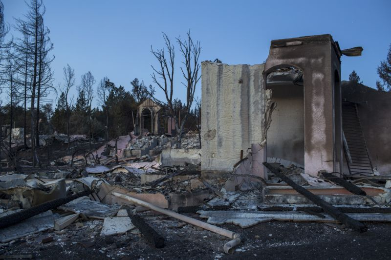 SANTA ROSA, CA -OCTOBER 14: The ruins of houses destroyed by the Tubbs Fire are seen near Fountaingrove Parkway on October 14, 2017 in Santa Rosa, California. At least 40 people are confirmed dead with hundreds still missing. Officials expect the death toll to rise and now estimate that 5,700 structures have been destroyed.