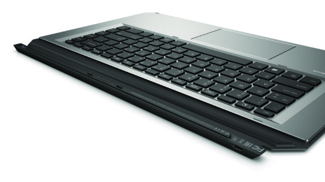 The keyboard is backlit. It uses a wired connection when attached to the tablet and Bluetooth when detached.