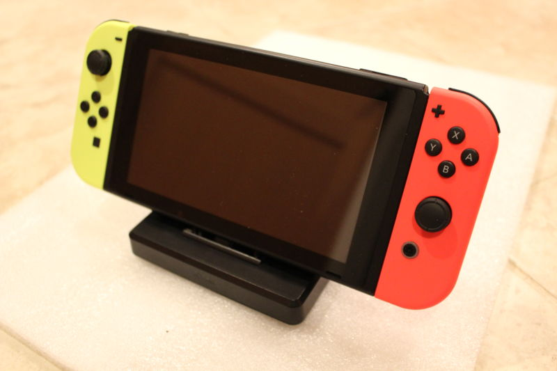 The author's Nintendo Switch, inserted into the Nyko Portable Docking Kit. (Cables aren't inserted into its backside for this product shot.)