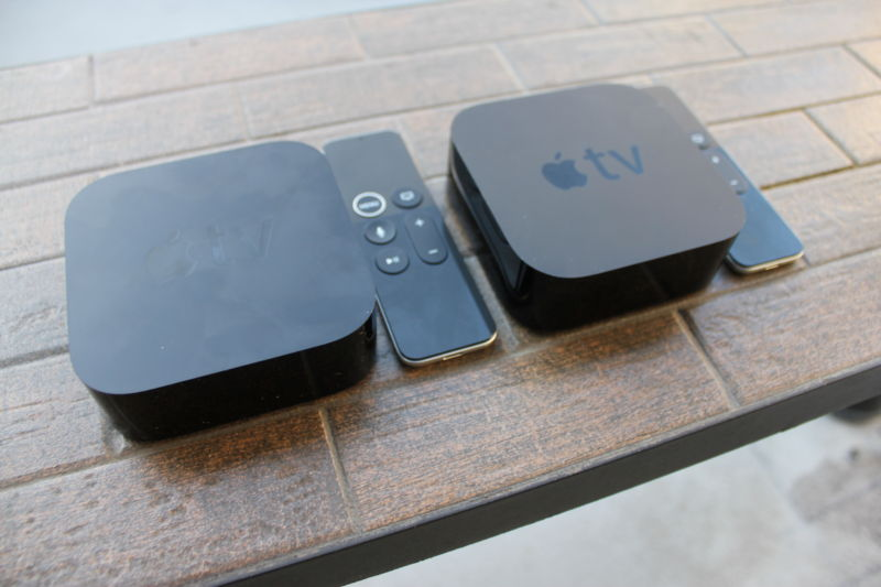 The Apple TV 4K and the Apple TV with their remotes.