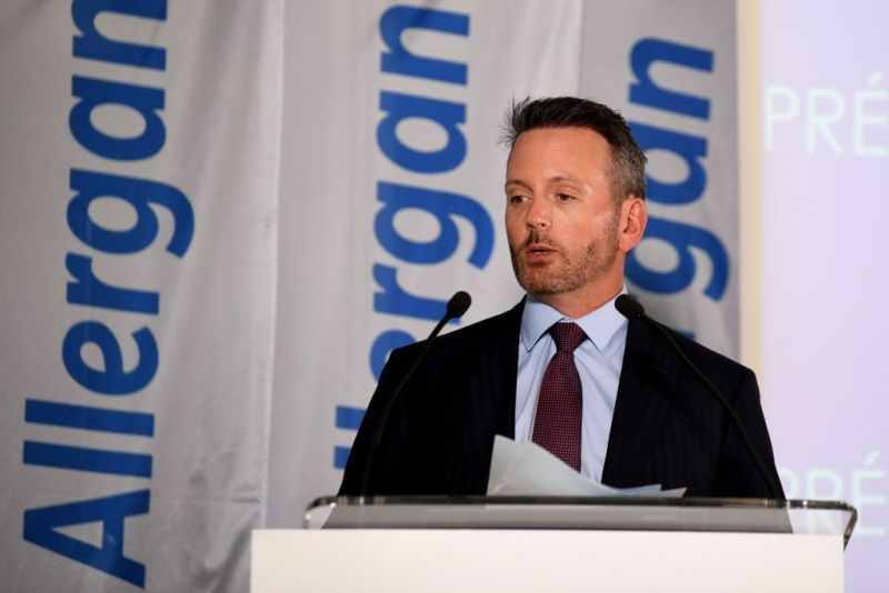 Allergan CEO Brenton Saunders addresses employees at a production facility in Pringy, France.