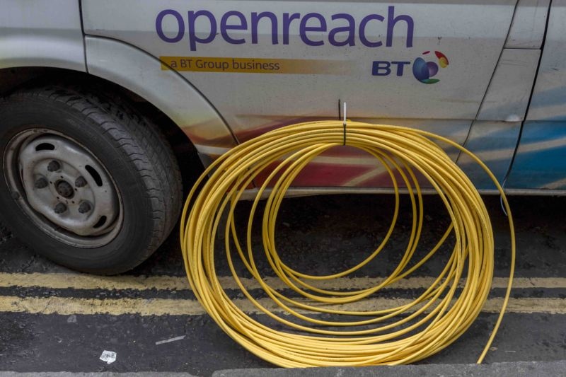 BT Openreach van and a coil of yellow broadband fibre cable awaiting installation in February 2017 in London, England.