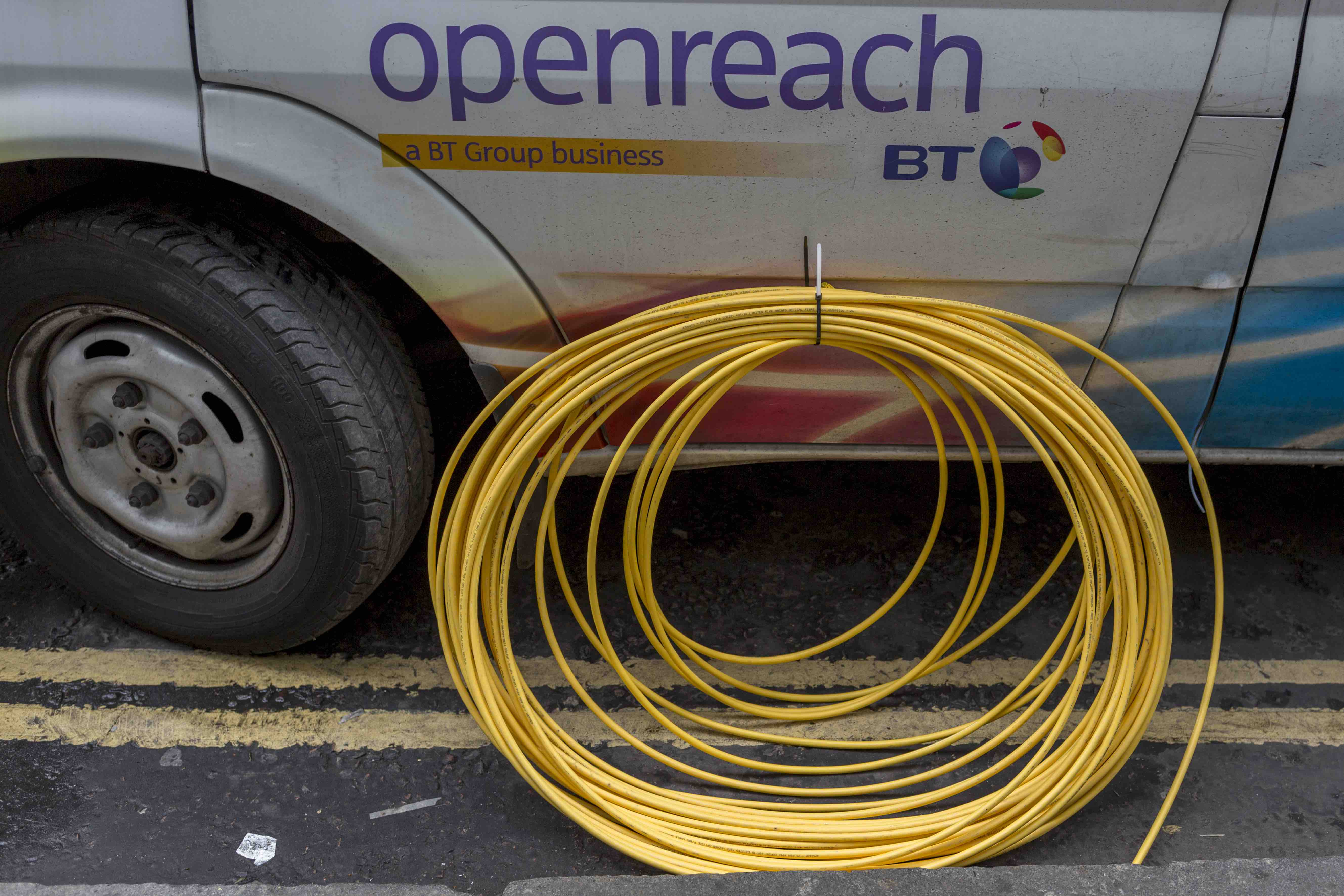 Advertised Broadband Speeds Should Actually Be Realistic Uk Tells Wiring Openreach Box Enlarge Bt Van And A Coil Of Yellow Fibre Cable Awaiting Installation In February 2017 London England