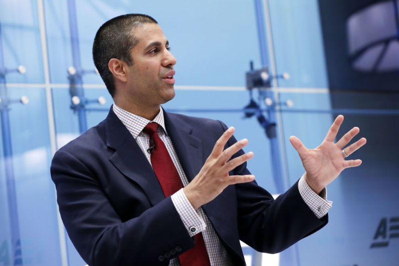 FCC Chairman Ajit Pai speaking and gesturing with his hands.