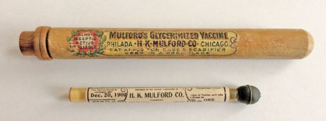 The original wooden and glass containers that held the capillaries with the Mulford 1902 smallpox vaccine.