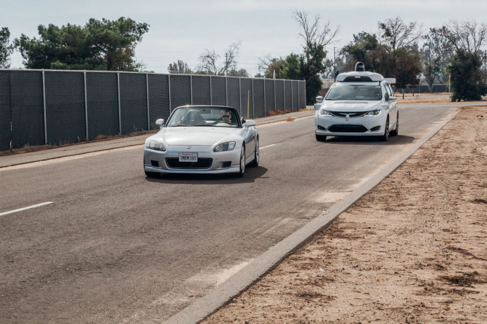 At Waymo's Castle testing facility in California, a Waymo self-driving car is cut off by another vehicle as part of a controlled test of Waymo's technology.