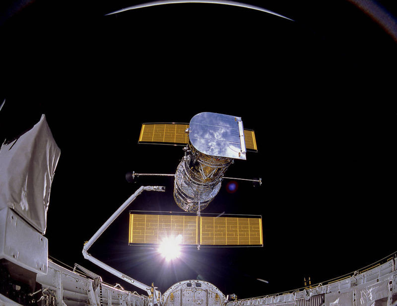 In 1990, Hubble leaves the safety of the space shuttle to begin its service.