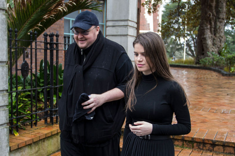 Kim Dotcom accompanied by his girlfriend Elizabeth-Donnelly appears in New Zealand's High Court on August 29, 2016 in Auckland, New Zealand. Dotcom and his law team are now challenging the extradition ruling against him.