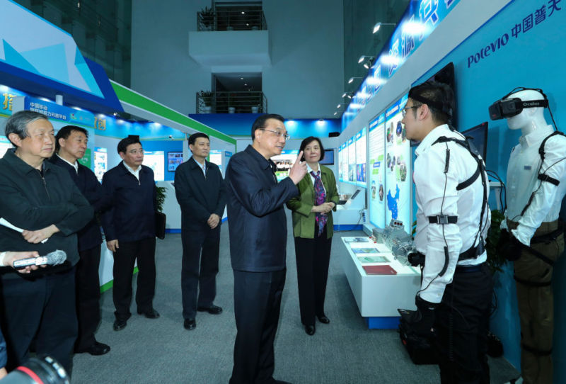 Chinese Premier Li Keqiang inspects the China Aerospace Science and Industry Corporation in Beijing on April 27, 2017.