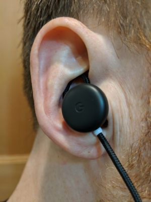 The author's ear, with a Pixel Bud wedged into it.