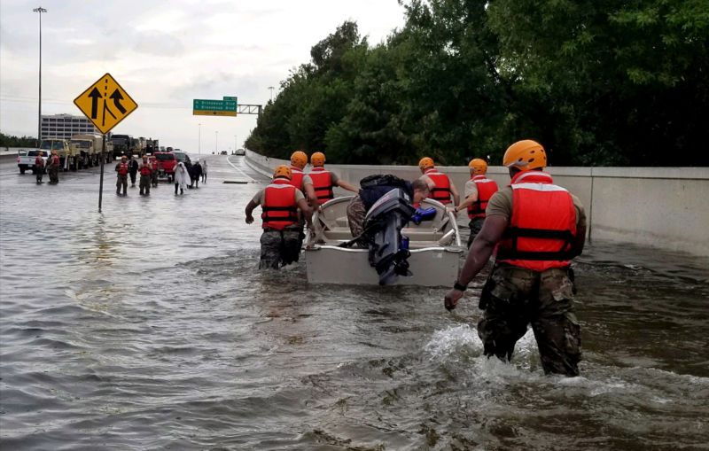 Members of the Texas Army National Guard moved through flooded Houston streets as floodwaters from Hurricane Harvey continued to rise on August 28, 2017. More than 12,000 members of the Texas National Guard were called out to support local authorities in response to the storm.