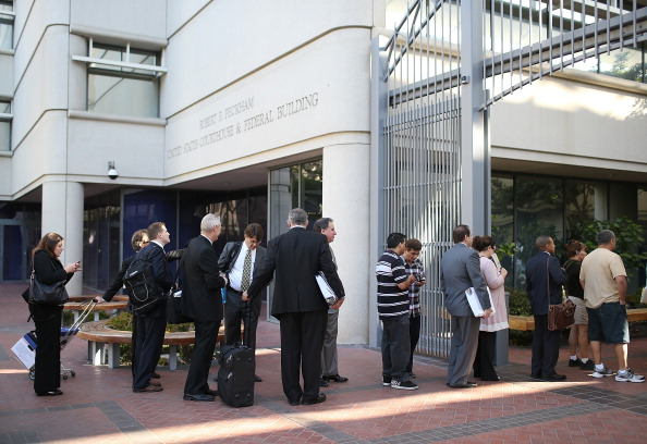 People line up to enter the federal courthouse in San Jose, California, in July 2012. It was the first day of trial in the patent battle between Apple and Samsung.