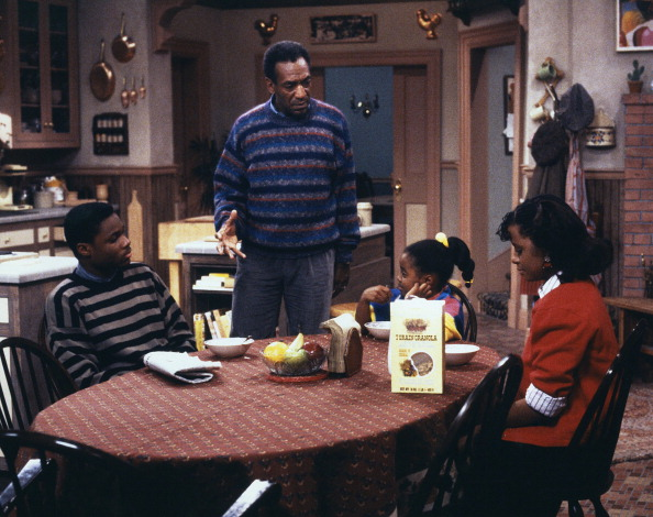 "THE COSBY SHOW—""Where's Rudy?"" Episode 10—Pictured: (l-r) Malcolm-Jamal Warner as Theodore 'Theo' Huxtable, Bill Cosby as Dr. Heathcliff 'Cliff' Huxtable, Keshia Knight Pulliam as Rudy Huxtable, Tempestt Bledsoe as Vanessa Huxtable."