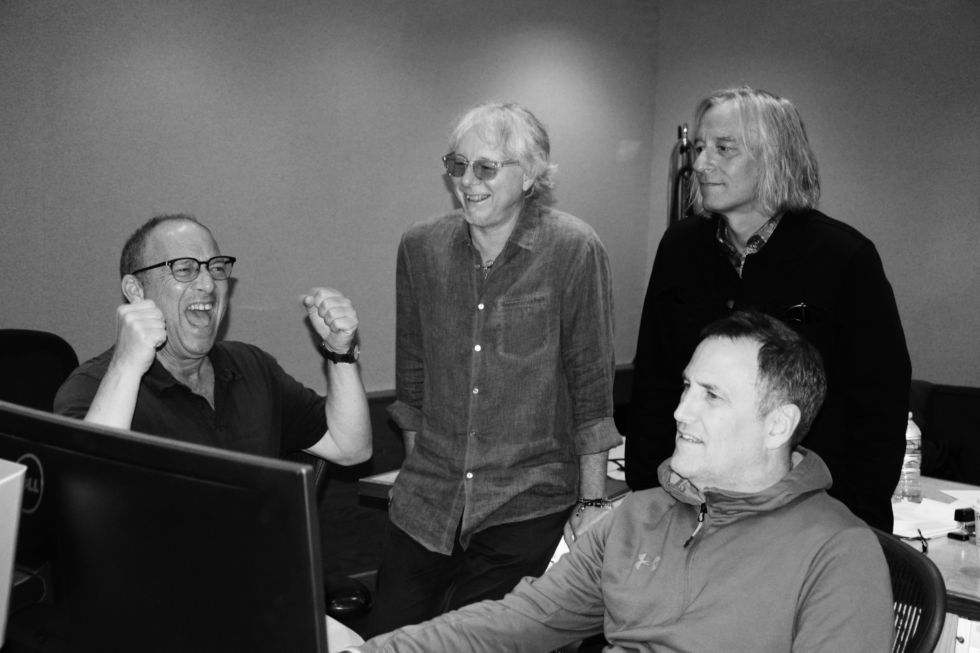L-R, Scott Litt, Mike Mills, Peter Buck, and Clif Norrell get excited about checking Facebook... or about remixing <em>Automatic For The People</em> in the Dolby Atmos format.