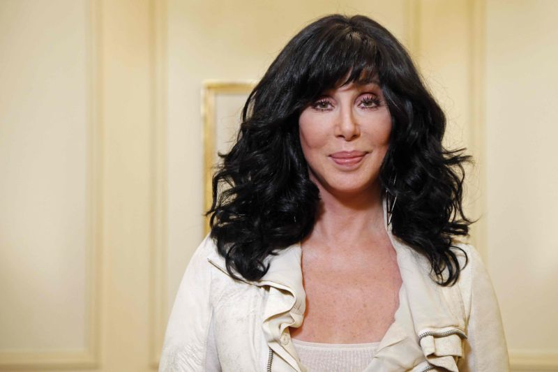 US singer and actress Cher poses on October 10, 2013 in Paris.