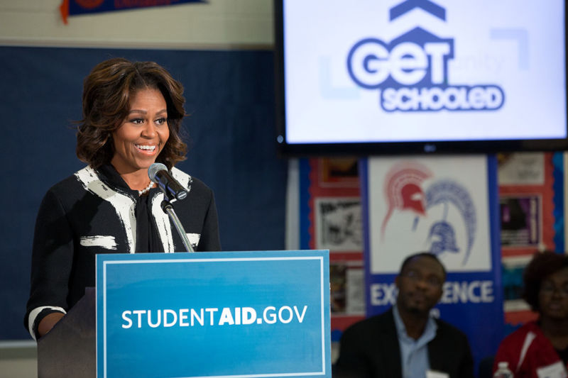 "Former First Lady Michelle Obama delivers remarks during a FAFSA workshop in 2014. Identity theft was not the kind of ""getting schooled"" the First Lady had in mind."