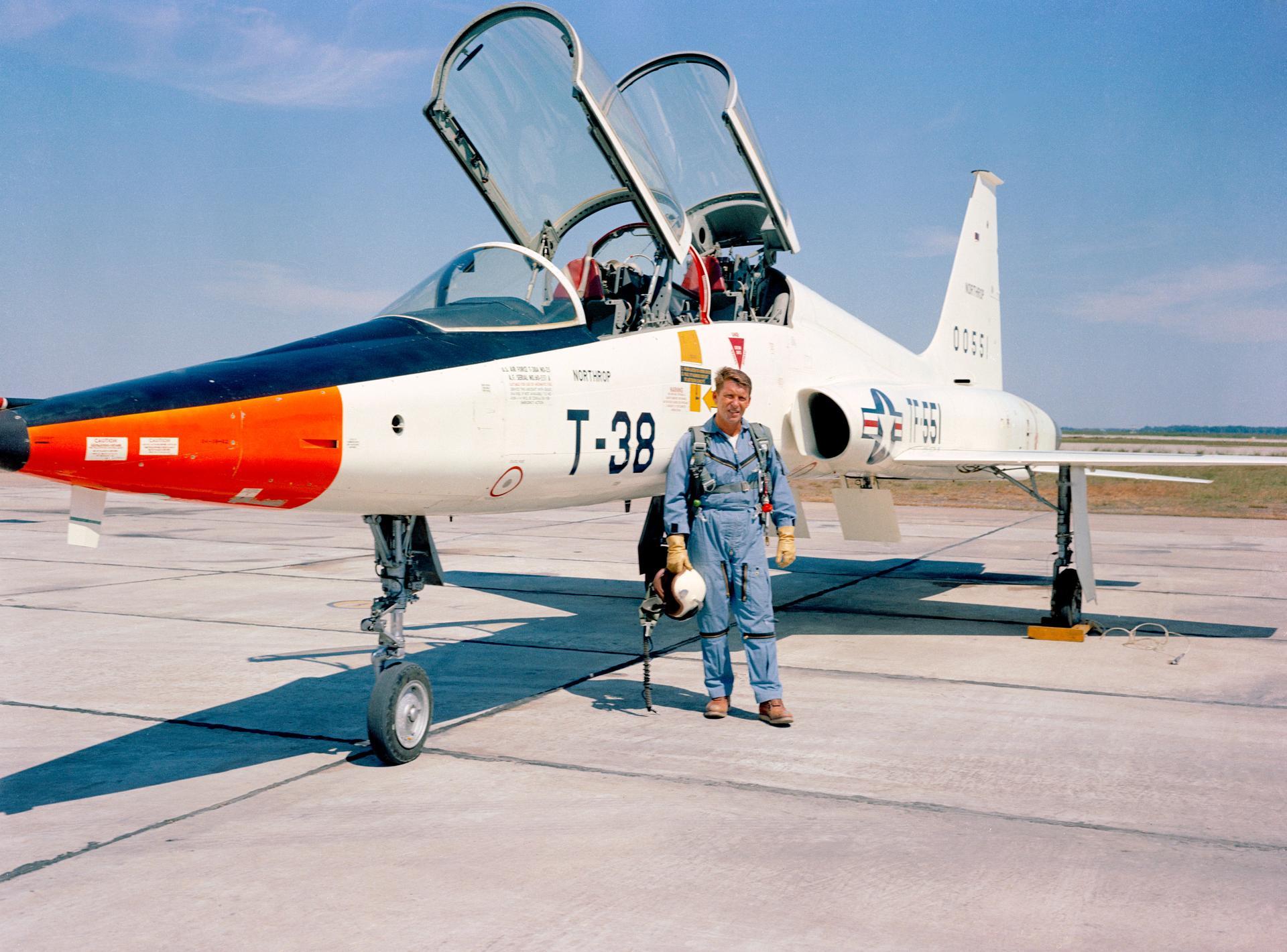astronaut walter m  schirra standing beside a t-38 in 1963