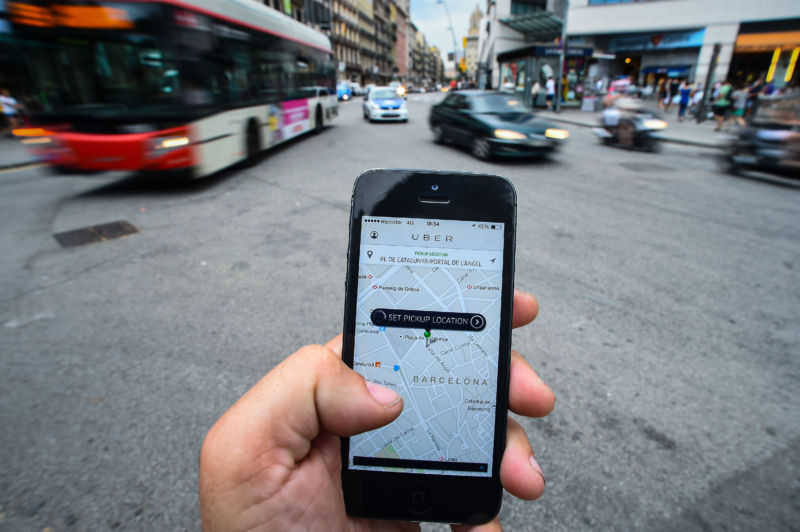 In this photo illustration the new smart phone taxi app 'Uber' shows how to select a pick up location on July 1, 2014 in Barcelona, Spain.