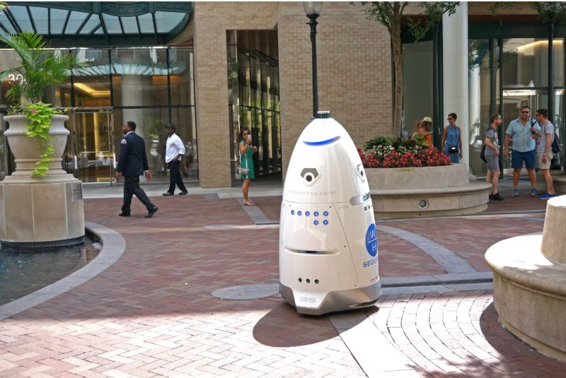 A five-foot-tall (1.5 meter) outdoor K5 security robot patrols the grounds of the Washington Harbour retail-residential center in the Georgetown district of Washington, DC, July 26, 2017.